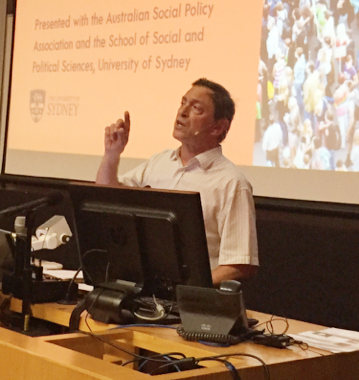 Photo of Guy Standing delivering lecture